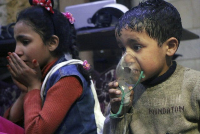 Syrian monitors say at least 14 killed in missile strike