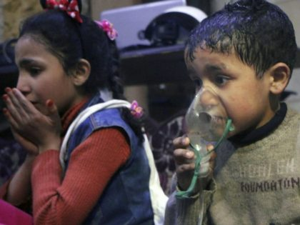 This image released early Sunday, April 8, 2018 by the Syrian Civil Defense White Helmets, shows a child receiving oxygen through respirators following an alleged poison gas attack in the rebel-held town of Douma, near Damascus, Syria. Syrian rescuers and medics said the attack on Douma killed at least 40 …