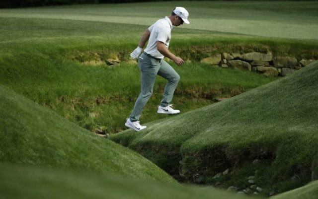 The Latest: Casey comes up short of Augusta scoring record