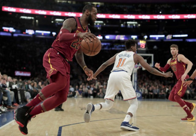 James, Love lead Cavs past Knicks to 50th win, Central title