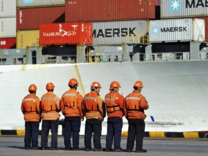 China US Trump Trade Chinese workers stand in front of a loaded cargo ship docked at a port in Qingdao in east China's Shandong province, Sunday, April 8, 2018. Amid falling markets, President Donald Trump's new economic adviser, Larry Kudlow, says there is no trade war between the U.S. and …