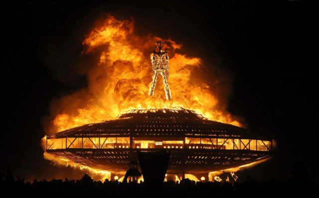 "In this Aug. 31, 2013, file photo, the ""Man"" burns on the Black Rock Desert at Burning Man near Gerlach, Nev. Burning Man founder Larry Harvey remains hospitalized in critical condition after suffering a stroke. The Burning Man organization on Monday, April 9, 2018, said Harvey suffered a massive stroke …"