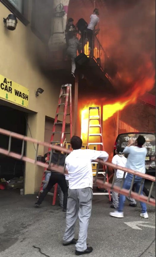 Girls jump, drop from balcony to escape dance studio fire