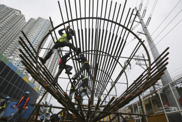 ADB raises Asia growth outlook, warns of trade tension risks