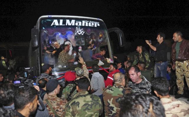 The Latest: Assad says Western threats based on 'lies'