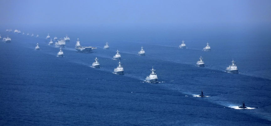 In this April 12, 2018 photo released by Xinhua News Agency, the Liaoning aircraft carrier is accompanied by navy frigates and submarines conducting an exercises in the South China Sea. China has announced live-fire military exercises in the Taiwan Strait amid heightened tensions over increased American support for Taiwan. The announcement by authorities in the coastal province of Fujian on Thursday was accompanied by a statement that the navy was ending a three-day exercise in the South China one day early. (Li Gang/Xinhua via AP)