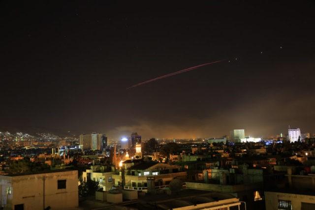 The Latest: Mattis says US strikes directed at Assad regime