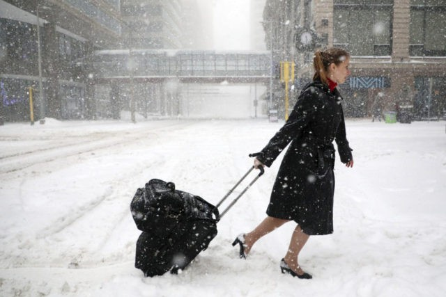 The Latest: Michigan braces for another day of snow and ice