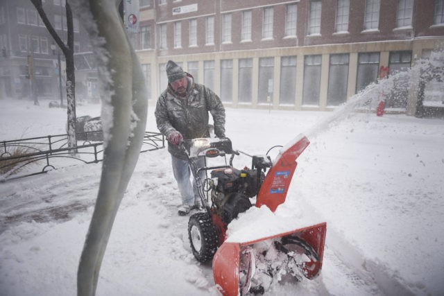 Spring storm keeps central US in icy grip, hampering travel