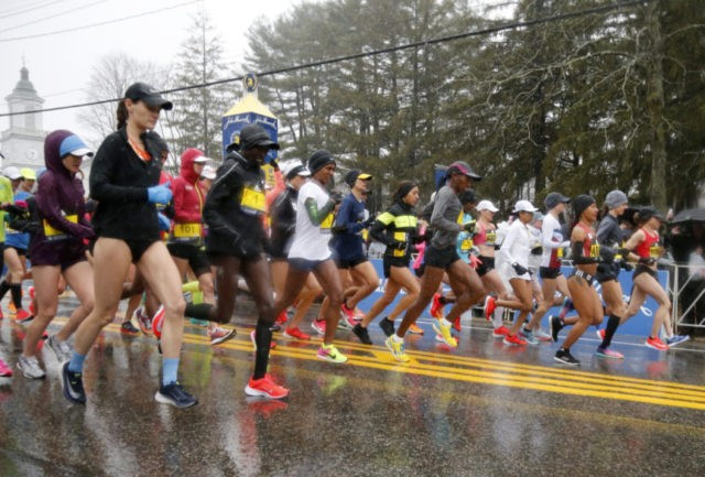 The Latest: Top women start wet, windy Boston Marathon