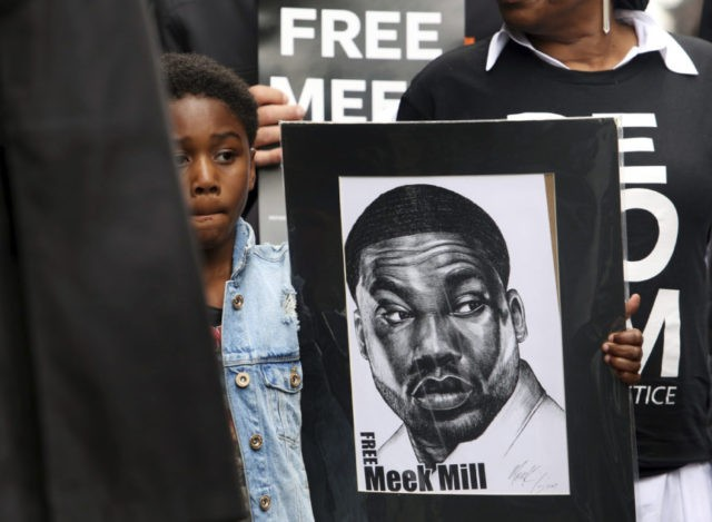 DA wants Meek Mill conviction tossed, but he remains jailed