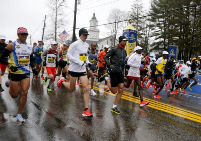 The Latest: Bad weather mean extra bib for Boston runners