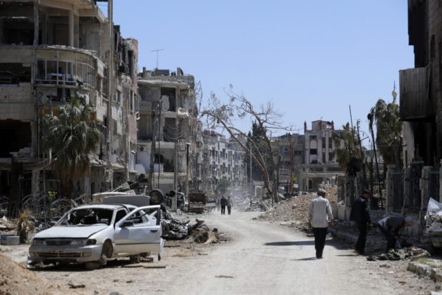 The Latest: Syrian TV: False alarm set off air defenses