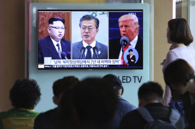 In this Wednesday, April 18, 2018, file photo, people watch a TV screen showing file footage of U.S. President Donald Trump, right, South Korean President Moon Jae-in and North Korean leader Kim Jong Un, left, during a news program at the Seoul Railway Station in Seoul, South Korea. The upcoming …