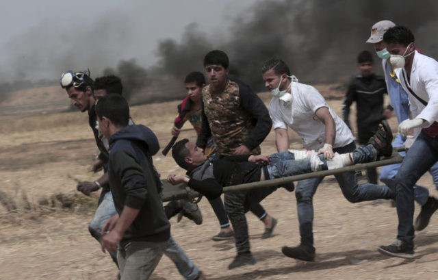 The Latest: Photog witnessed Palestinian teen being shot