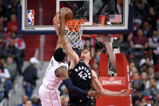 Wall takes over, Wiz beat Raps 106-98 to tie series at 2-2