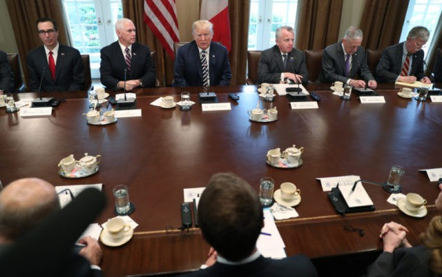 Trump calls Kim open, honorable as summit planning goes on