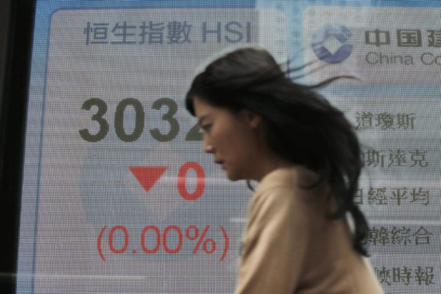 Asian markets mixed as investors consider latest earnings