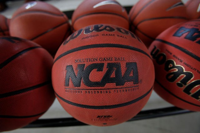College basketball commission wants NCAA to regulate agents