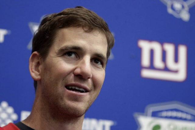 Giants' Manning more concerned with new offense than draft