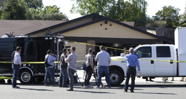 The Latest: Brother of serial killer's victims cheers arrest