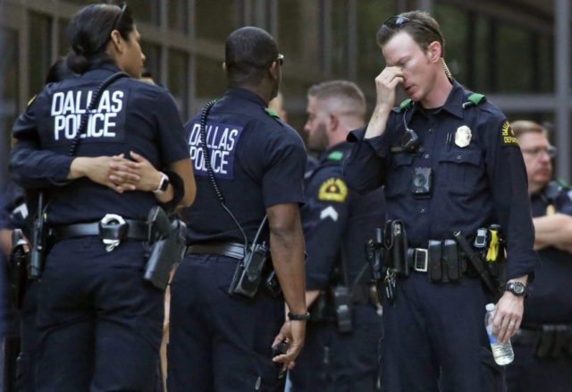 Gunman wounds 2 Dallas police officers, store employee