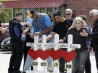 Family members of people killed at a Waffle House restaurant write messages on wooden crosses set up as a memorial Wednesday, April 25, 2018, in Nashville, Tenn. Four people were killed when a gunman opened fire at the restaurant Sunday. Members of the Waffle House management and staff joined the …