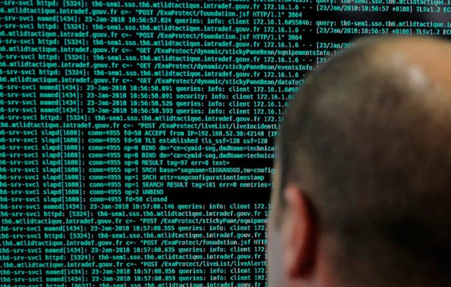 In this Jan.23 2018 file photo, a French solider watches code lines on his computer at the French Defense ministry stand during the International Cybersecurity forum in Lille, northern France. Police in Europe and North America have seized servers and data from Islamic State propaganda outlets in a multi-country operation …