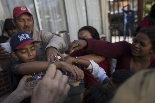 Asylum-seekers in Mexico snub warnings of stern US response