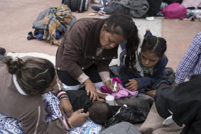 The Latest: Migrants in caravan start seeking US asylum