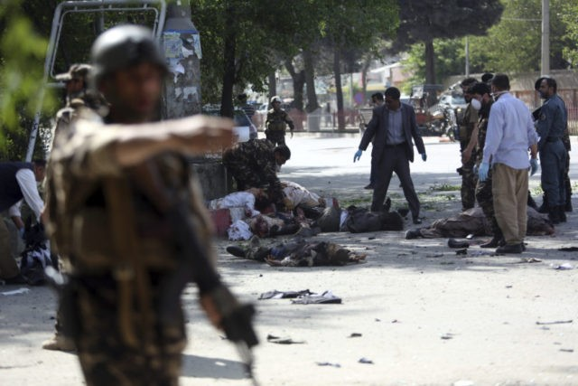 The Latest: Suicide blast in south Afghanistan kills 11 kids