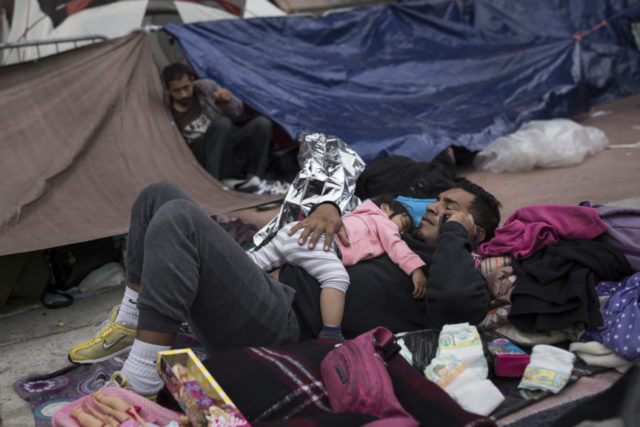 Migrants in caravan criticized by Trump start seeking asylum