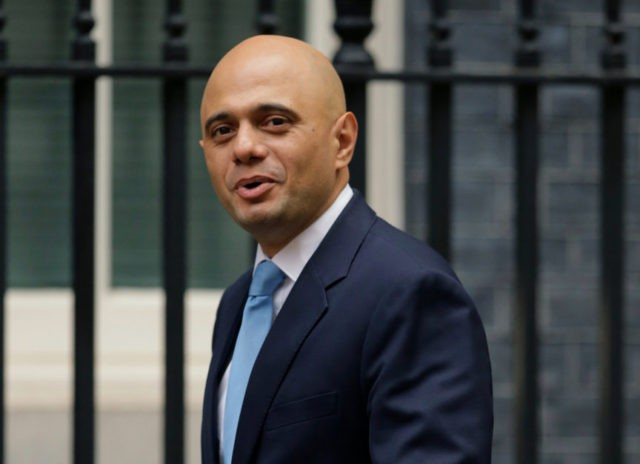 New UK interior minister vows to resolve immigration scandal