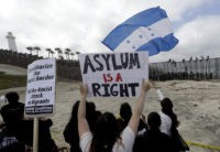 The Latest: Some caravan of asylum seekers waiting at border
