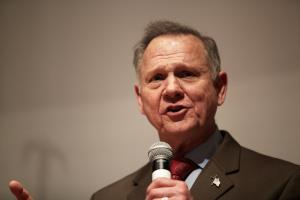 Roy Moore sues three accusers, citing 'political conspiracy'