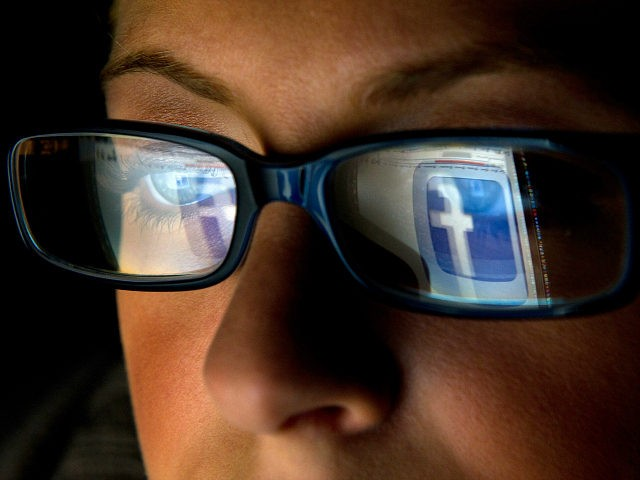 FILE: In this file photo the Facebook Inc. logo is reflected in the eyeglasses of a user in this arranged photo in San Francisco, California, U.S., on Wednesday, Dec. 7, 2011. A Facebook IPO would provide funds to help the social-networking service maintain its expansion and fend off competition from …