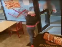 A woman smashed the front window of a Popeyes restaurant, reportedly because she wasn't given a soda with her Wicked Good Deal.