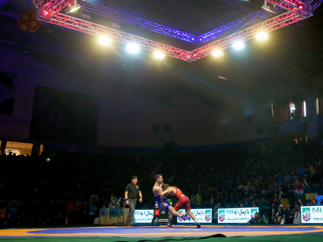 USA's Frank Aniello Molinaro (R) competes with Iranian Meysam Nasiri (L) during the 65 kg category final match at the World Wrestling Cup Final in the western Iranian Kurdish-majority city of Kermanshah on February 17, 2017. Iran won the tournament in five out of eight weight categories following three days …