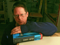 "In this Nov. 23, 2005 file photo, Author William T. Vollmann poses in his studio in Sacramento, Calif., Nov. 23, 2005, with his novel ""Europe Central,"" Nominees for the National Book Critics Circle prize were announced, Saturday, Jan. 23, 2010 and include William T. Vollmann, Hilary Mantel, Jayne Anne Phillips, …"