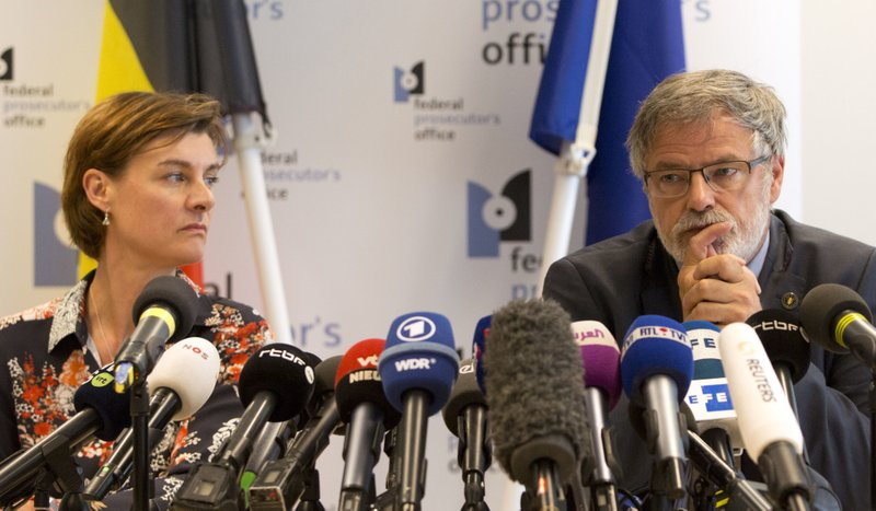 Belgian Federal Prosecutor Eric Van Der Sypt, right, and Federal Prosecutor Wenke Roggen address a media conference in Brussels, Wednesday, May 30, 2018. A gunman killed three people, including two police officers, in the Belgian city of Liege on Tuesday. Police later killed the attacker, and other officers were wounded in the shooting. (AP Photo/Virginia Mayo)