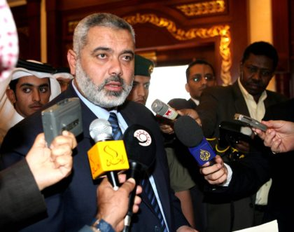 Visiting Palestinian Prime Minister Ismail Haniya talks to reporters at a press conference at Doha International Airport before his departure on Sunday, Dec 3, 2006. (AP Photo/Hamid Jalaludin)