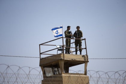 Israeli soldiers guard on top of a watch tower in a community along the Israel- Gaza Strip Border, Tuesday, May 15, 2018. Thousands joined funeral processions Tuesday for some of the dozens of Palestinians killed by Israeli troops in a mass march on the Gaza border, as Israelis faced growing …