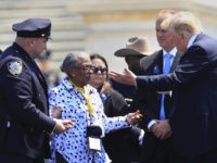 President Donald Trump greets Adrianna Valoy, the mother of New York Police Department detective Miosotis Familia, who was killed in the line of duty, during the 37th Annual National Peace Officers' Memorial Service on Capitol Hill in Washington, Tuesday, May 15, 2018. (AP Photo/Manuel Balce Ceneta)