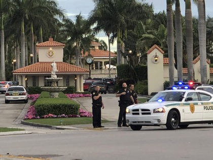 Police respond to The Trump National Doral resort after reports of a shooting inside the resort Friday, May 18, 2018 in Doral, Fla. A man shouting about Donald Trump entered the president's south Florida golf course early Friday, draped a flag over a lobby counter and exchanged fire with police …