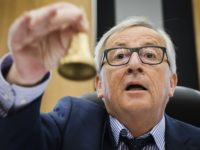 EU Commission President Jean-Claude Juncker rings the bell as he opens the college of commissioners at EU headquarters in Brussels, Wednesday, May 23, 2018.