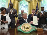 President Donald Trump center, posthumous pardons Jack Johnson, boxing's first black heavyweight champion, during an event in the Oval Office of the White House in Washington, Thursday, May 24, 2018. Trump is joined by, from left, Linda Haywood, who is Johnson's great-great niece, heavyweight champion Deontay Wilder, Keith Frankel, Sylvester …