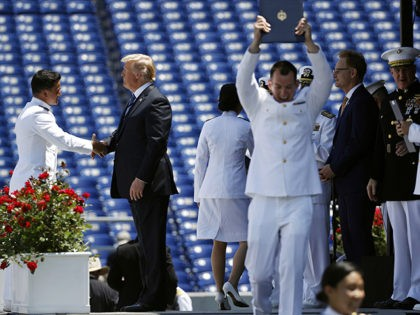 President Donald Trump shakes hands with a graduating U.S. Naval Academy midshipman during the Academy's graduation and commissioning ceremony, Friday, May 25, 2018, in Annapolis, Md. (AP Photo/Patrick Semansky)