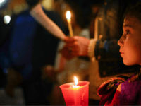 People hold candles as they attend a prayer vigil for terminally ill toddler Alfie Evans, in St. Peter's Square at the Vatican, Thursday, April 26, 2018. The British hospital treating Alfie Evans withdrew his life support Monday after a series of court rulings sided with the doctors and blocked further …