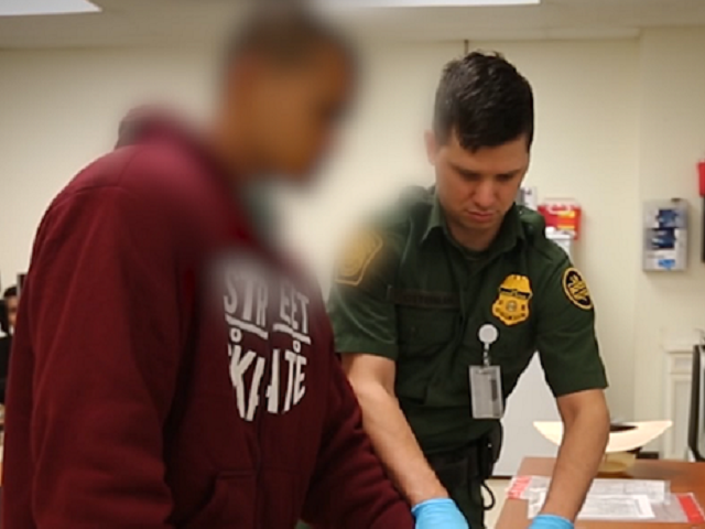 Laredo Sector Border Patrol agent processes a Bangladeshi national after he illegally crossed the border from Mexico. (Photo: U.S. Border Patrol, Laredo Sector)