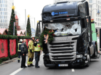 TOPSHOT - View of the truck that crashed the evening before into a christmas market at Gedächtniskirche church on early December 20, 2016 in Berlin. German police said December 20, 2016 they were treating as 'a probable terrorist attack' the killing of 12 people when a lorry ploughed through a …